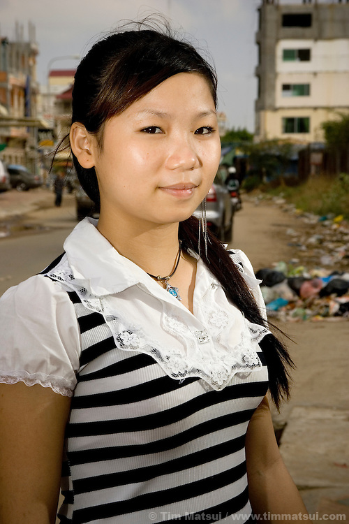 A portrait of a resident at Transitions Cambodia, an aftercare shelter for young women 15 years and older who have been trafficked and sexually exploited, in Phnom Penh, Cambodia. Most aftercare shelters work with women 15 years and younger while Transitions uses an open residential facility model where the young women come and go like any other teenager might, going to school, their jobs, and seeing friends. The concept is intended to instill a sense of dignity and responsibility in the young women so they can find their own voice and understand they have a choice, something that sexual trauma often robs from survivors.