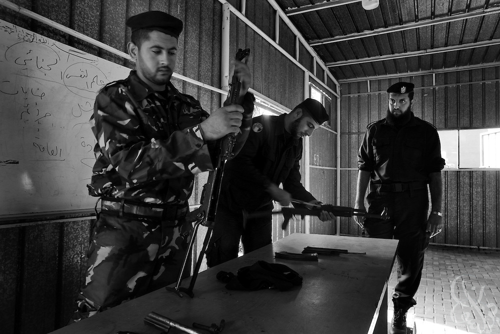 HAMAS border police undergo basic weapons training December 22, 2009 at the City of Arafat Police headquarters in Gaza City, Gaza. The HAMAS police force was one of the main targets of the 22 day Israeli offensive a year ago and lost more than 150 members on the first day of strikes alone. The past year has seen HAMAS slowly rebuild its capacity, although the organization is careful not to congregate in large groups and only trains now in small numbers to avoid being an easy target again.