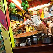 A vendor is making Pao Bhaji, a famous street food dish, at a food stall on Juhu Chowpati beach. Mumbai, August 2009