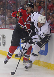 May 30; Newark, NJ, USA; Los Angeles Kings left wing Dwight King (74) hits New Jersey Devils defenseman Anton Volchenkov (28) during the first period of 2012 Stanley Cup Finals Game 1 at the Prudential Center.  The Kings defeated the Devils 2-1.