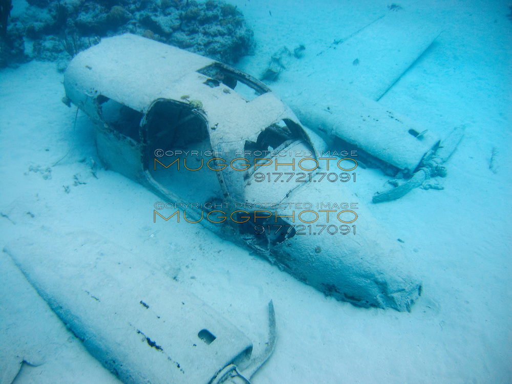 a two seater airplane underwater in The Bahamas