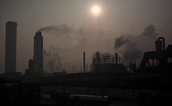 A view of thick smoke billowing from Jinhuarun Chemical Industry plant in a chemical industry park in Zekou Town, Qianjiang City of Hubei Province, China 15 January 2013. While the heavy smog in Beijing and much of northern China in recent days have caused alarm among residents and renewed scrutiny on the pollution woes of the country, villagers in a small town of Hubei Province have been grappling with severe air, water and noise pollution on a daily basis over the past two years. China's Xinhua news reported 04 January 2013 that more than 60 cancer deaths in various villages of Zekou Town has been caused by the heavy pollution from the chemical industry park nearby. About 20 or more chemical plants built around the villages of Dongtan, Xiangnan, Zhoutan, Sunguai, Qingnian and others over the past two years has created huge increases in noise, air and water pollution. Many villagers complained of intensifying respiratory, heart, skin and circulatory illnesses caused by the pollution and a large spike in cancer diagnoses and deaths since the factories were built. .