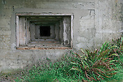 Wood-lined gun embrasure of a German WWII bunker. The stepping form and wood lining were designed to minimise shrapnel entering the opening during an attack. Alderney, Channel Islands, 2006