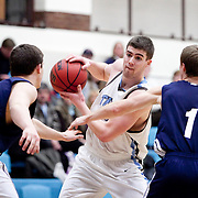 20110210 - Medford, Mass. - Tufts forward Scott Anderson (A13) wrestles for possession in Tufts 69-47 win over Gordon at Cousens Gymnasium on Feb. 10, 2011....(Kelvin Ma/Tufts University)