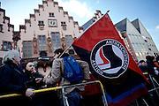 Frankfurt am Main | 30 Mar 2015<br /> <br /> Am Montag (30.03.2015) demonstrierten etwa 40 Menschen unter dem Namen &quot;Freie B&uuml;rger f&uuml;r Deutschland&quot; auf dem R&ouml;merberg in Frankfurt am Main gegen Islamisierung und zahlreiche andere &Uuml;bel, die Gruppe war zuvor unter dem Namen &quot;PEGIDA&quot; aufgetreten. Etwa 600 Menschen protestierten lautstark gegen diese Kundgebung.<br /> Hier: Gegendemonstranten mit der Fahne &quot;Antifaschistische Aktion&quot; vor dem R&ouml;mer.<br /> <br /> &copy;peter-juelich.com<br /> <br /> [No Model Release | No Property Release]