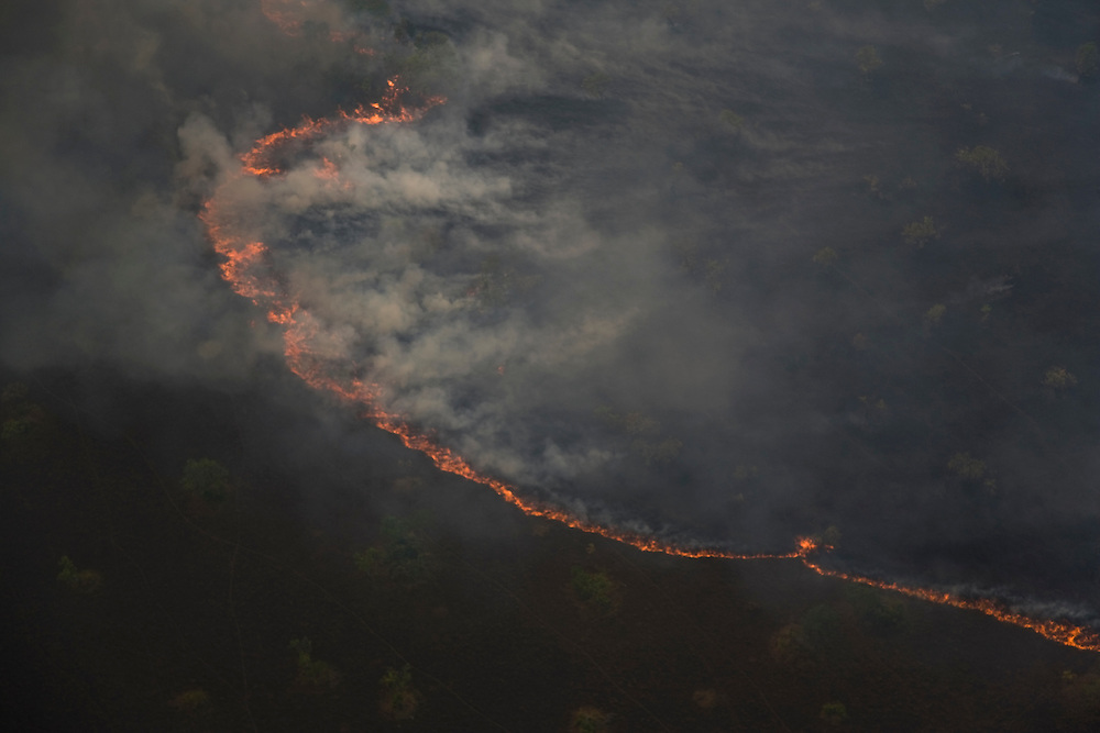 Para State, Brazil. August 28th 2007. Flight from Alta Floresta (Brazilian Amazon). Aerial view of the rainforest during the burning season were big sections are set on fire by farmers to be cleared for soy farming or cattle grazing.