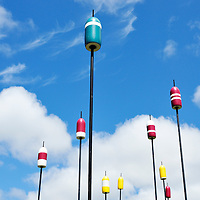 Lobster fishing buoys on poles as outdoor art installation on Hyannis Harbor, Cape Cod
