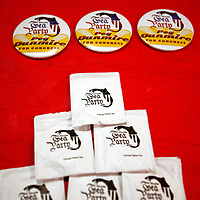 ORLANDO, FL -- October 21, 2010 -- Tea packets and buttons for Florida Tea Party congressional candidate Peg Dunmire sit on a table during a debate at Jones High School in Orlando, Fla., on Thursday, October 21, 2010.