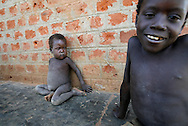October 6, 2006 - Two children sit next to a school in Coope camp for internally displaced people, or IDP, near Gulu in north Uganda. Coope, with a population of 18,000, is one of 76 IDP camps around Gulu, the main base for the Uganda Peoples Defense Force fighting the insurgent Joseph Kony's Lord's Resistance Army. Kony's LRA movement has been fighting for the past 20 years to force the East African country to be ruled according to the Christian Ten Commandments. Over 2 million people, mostly of the Acholi tribe, have moved or were forced to move from their villages to camps close to the towns of Gulu, Lira, and Kitgum where they are watched over by the Ugandan Army. The LRA rebels have abducted thousands of children and have forced them to fight against the Ugandan Army and the Acholi people. Current peace talks between Kony's LRA and the Ugandan government held in Juba, southern Sudan, offer a glimpse of hope to ending this ongoing conflict..(Photo by Jakub Mosur/Polaris)<br />