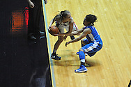 "Ole Miss' Maggie McFerrin (14) is forced out of bounds by Kentucky's Jennifer O'Neill (0) for a turnover at the C.M. ""Tad"" Smith Coliseum in Oxford, Miss. on Thursday, February 28, 2013. Kentucky won 90-65."
