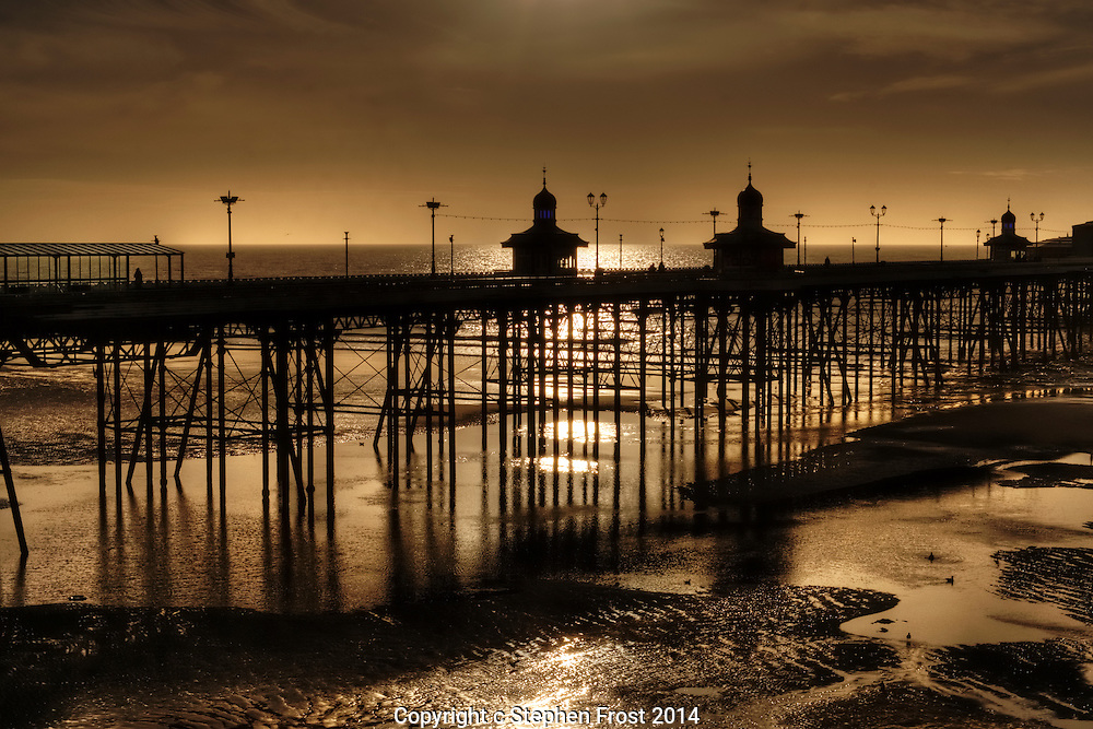 Blackpool Beach and North Pier during an evening ebb tide.