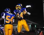 Oxford High's D.K. Metcalf (14) makes a touchdown catch with 1:52 remaining in the 4th quarter vs. Jackson Prep and celebrates with Oxford High's William Paine (54) in Oxford, Miss. on Friday, August 23, 2013. Oxford won 32-20.
