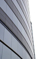 modern corporate office building with curved exterior