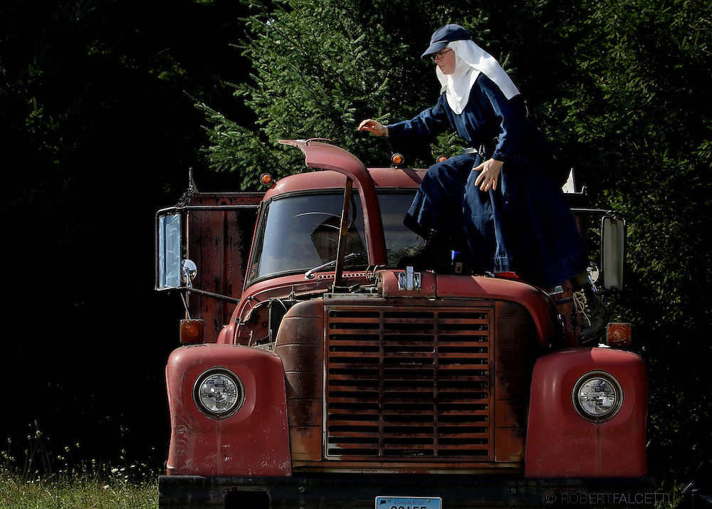 BETHLEHEM, CT- 11 OCTOBER 2005-Sister Ozanne Schumann works on a 1968 International Loadstar 1600 truck at the Abbey of Regina Laudis. Sister Ozanne, who has been at the abbey for 10 years, got the old truck running and now it used on the abbey's farms. <br /> (Photo by Robert Falcetti)