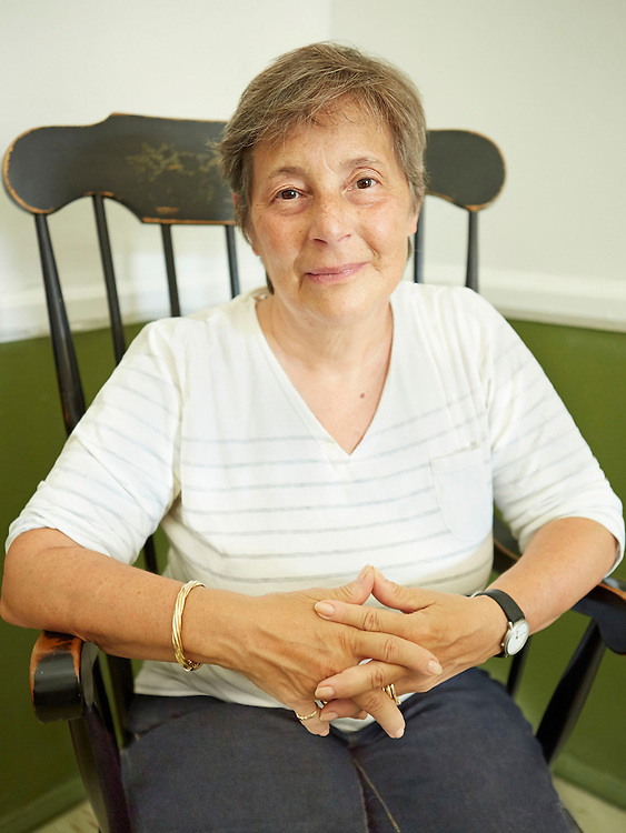 Portrait photograph of senior woman sitting and relaxing in antique chair