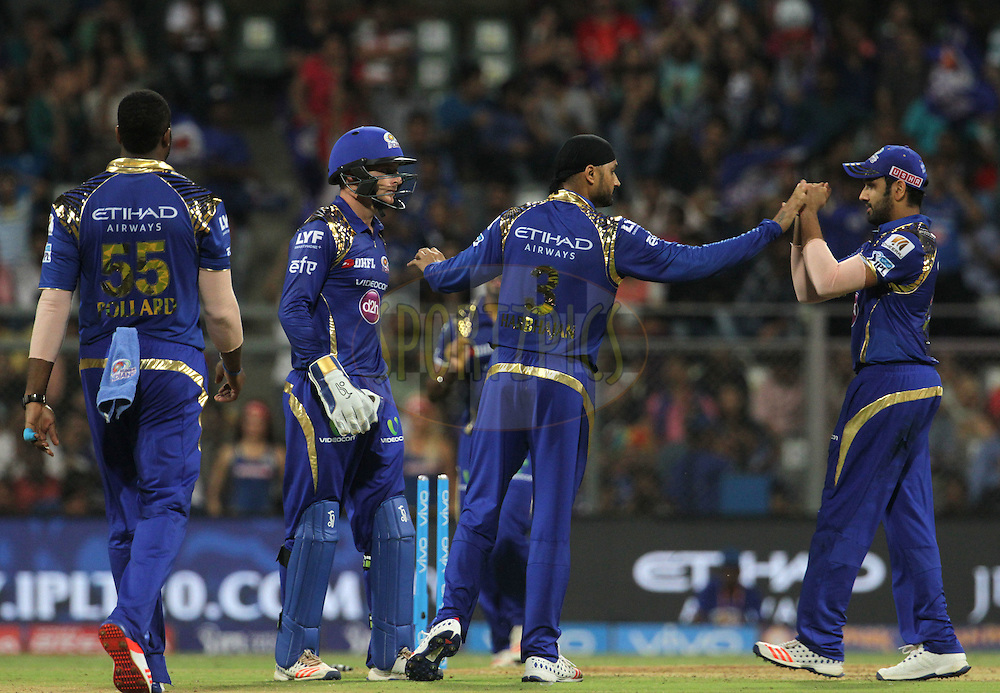 Mumbai Indians celebrates the wicket of Rising Pune Supergiants player Faf du Plesis during match 1 of the Vivo Indian Premier League ( IPL ) 2016 between the Mumbai Indians and the Rising Pune Supergiants held at the Wankhede Stadium in Mumbai on the 9th April 2016<br /> <br /> Photo by Vipin Pawar/ IPL/ SPORTZPICS