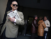 A Spanish citizen leaves the Colegio de Nuestra Senora del Buen Consejo after voting in the Spanish Elections, in Madrid, Spain, on Sunday, March. 9, 2008. Today Spanish citizen will vote for a new prime minister. Photographer: Markel Redondo/Fedephoto.