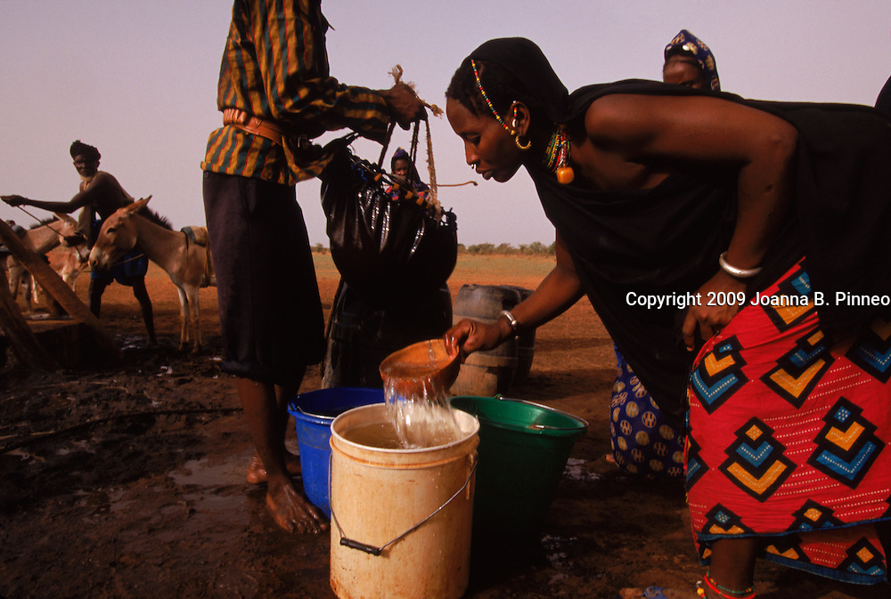 Mali, West Africa.     Village of Teidoum near the Mauritanian border. People getting water from the well. Aurora image #1887404601