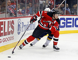 December 28, 2007; Newark, NJ, USA;  New Jersey Devils defenseman Paul Martin (7) skates around the Devils goal during the first period at the Prudential Center in Newark, NJ.
