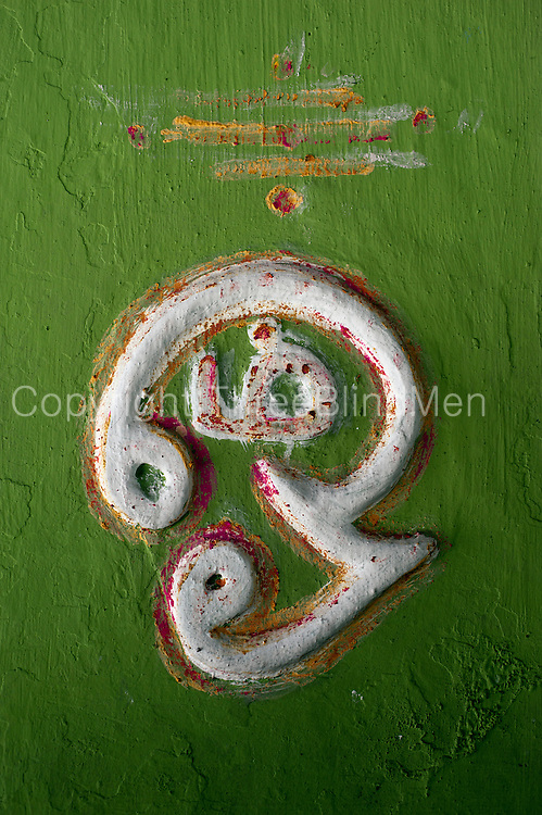 'Om' symbol on wall of small kovil in Thirukovil