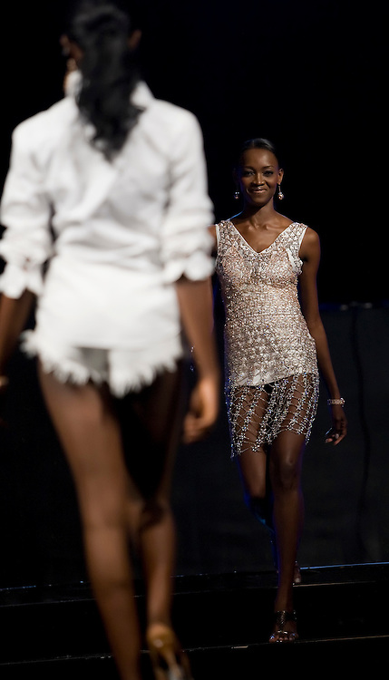 "Famed Nigerian super model Oluchi (r) models a Chris Aire designed outfit during the July 13, 2008 leg of the ThisDay music and fashion festival in Lagos, Nigeria. The festival, themed ""Africa Rising"", aims to raise awareness of African issues while promoting positive images of Africa using music, fashion and culture in a series of concerts and events in Nigeria, the United States and the United Kingdom. ."