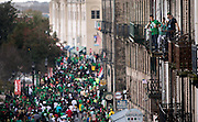 Visitors watch thousand of revelers from their hotel balcony during St. Patrick's Day celebration Saturday, March 14, 2015, on River Street in Savannah, Ga. Thousands of gaudy green visitors are in Savannah this weekend to kick off a four-day celebration that peaks Tuesday with the St. Patrick's Day parade. (AP Photo/Stephen B. Morton)