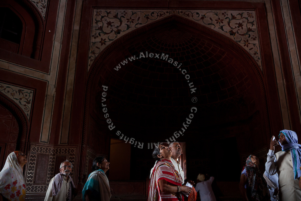 Visitors are entering the Taj Mahal complex through the Great Gate, in Agra.