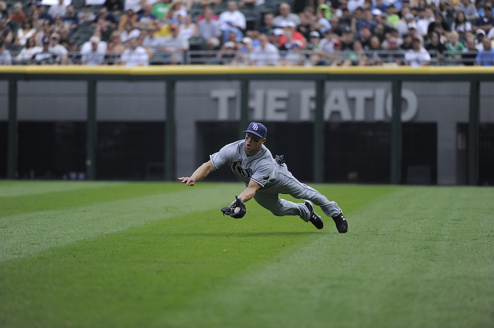 CHICAGO - JULY 23:  Gabe Kapler #27 of the Tampa Bay Rays makes a diving catch in the third inning against the Chicago White Sox on June 23, 2009 at U.S. Cellular Field in Chicago, Illinois.  The White Sox defeated the Rays 5-0 as White Sox pitcher Mark Buehrle #56 pitched a perfect game.  (Photo by Ron Vesely)