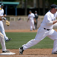 UNCW's Corey Dick forces Hofstra's Eric Ferguson out at first base. (Jason A. Frizzelle)