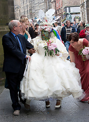 Elaine Davidson, the world's most pierced woman, got married in Edinbugh to Douglas Watson. The happy couple walk down High Street..