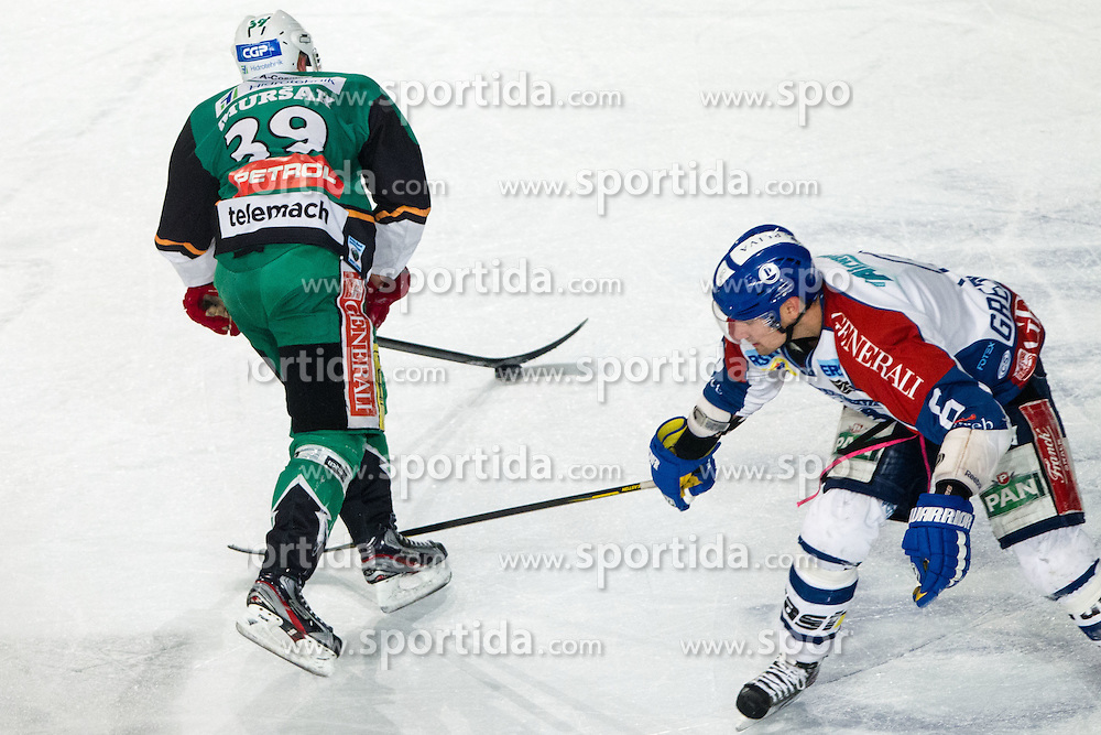 06.01.2012, Stadium Bezigrad, Ljubljana, SLO, EBEL, HDD Telemach Olimpija Ljubljana vs KHL Medvescak Zagreb, 39. Runde, in picture Jan Mursak (HDD Telemach Olimpija, #39) and Kyle Greentree (KHL Medvescak Zagreb, #6) during the Erste Bank Icehockey League 39th Round match between HDD Telemach Olimpija Ljubljana and KHL Medvsecak Zagreb at the open ice winter classic Stadium Bezigrad, Ljubljana, Slovenia on 2013/01/06. (Photo By Matic Klansek Velej / Sportida)