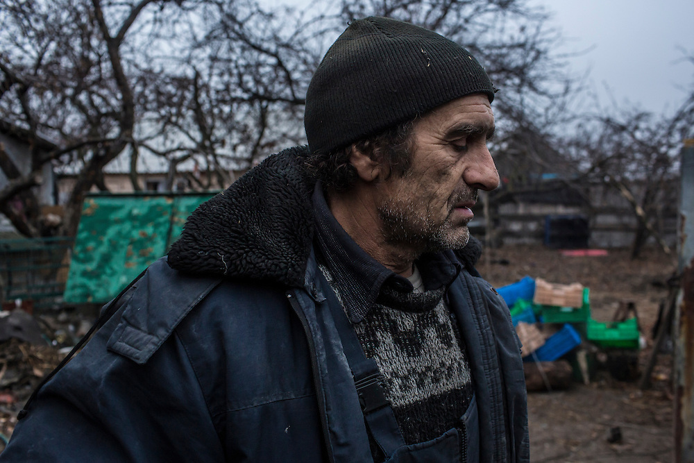 PIKSY, UKRAINE - NOVEMBER 19, 2014: Yuri Siderov, who lives with his wife Lyubov in Pisky, Ukraine. The village of Pisky is the scene of much of the front-line fighting over the Donetsk airport, but Siderov and his wife have stayed to care for their two cows. CREDIT: Brendan Hoffman for The New York Times