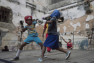 Training session at gimnasio de boxeo Ni&ntilde;os De Cuba - Havana - cuba<br /> <br /> The Cuban boxing has a centennial long prestigious history written by exceptional champions, artists of the ring, whose legendary exploits , continue to live in the stories of fans. In 1962 Cuba had abolished professionalism in sports. Two years ago, driven by economic interests and attempt to stop the bleeding of athletes on the run from the island, sports authorities have announced participation in world boxing championship, the World Series of Boxing (WSB), which are not however a professional circuit because they remain part of the Olympic boxing. Thanks to a law passed a few years ago, with new economic conditions for the Cuban athletes, now, in addition to the contributions they receive from the state, the Cuban boxers will earn from their sport, 80% of the proceeds from participation in international sporting events.<br /> Meanwhile two years ago, in a small corner of Centro Habana, two blocks from the Capitolio and the square of big international hotels such as Telegraph and England, between the peeling walls of two buildings, in the space left by a collapsed building,<br /> thanks also the association Italian Malaika (Angel in swahili), there is a gymnasium de Boxeo, a gym of wooden planks recycled for the children of Centro Habana. In this neighborhood gym the talent and enthusiasm of dozens of children between 7 and<br /> 20 years is concentrated: Los Ninos de Cuba. Every day from 5 pm until late at night they chasing their dreams of success, with ethics, rigor and commitment, The facilities are not enough for everyone. Gloves and shoes alternate in the hands and feet of small boxeadores, which in turn &ldquo;peleano&rdquo; on the makeshift ring waiting to make the leap to the Rafael Trejo, another Boxing Gymnasium, in the heart of Havana Vieja, to participate in provincial and then national championships. From these gyms the best of the little boxers move to the EIDE (Escuelas de Iniciaci&oacute;n Deportiva Escolar)