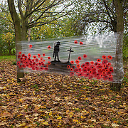 A makeshift artistic memorial to those fallen in past wars, stretched across trees in Hilly Fields, Ladywell, south London.