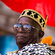 Chief Nana Kojo Abaka IV sits in a palanquin carrried by followers during the parade held on the occasion of the annual Oguaa Fetu Afahye Festival in Cape Coast, Ghana on Saturday September 6, 2008..