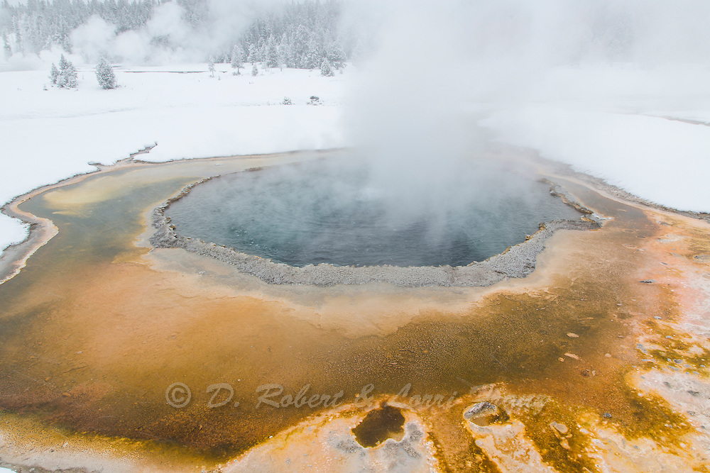 Hot spring in the Upper Geyser Basin of Yellowstone National Park during winter