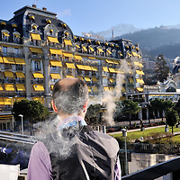 Geneva 2 Syria talks, taking place in Montreux, at the Montreux Palace Hotel. Journalist smoking.