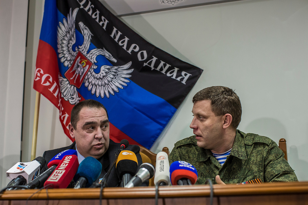 DONETSK, UKRAINE - FEBRUARY 2, 2015: Igor Plotnitsky, left, the head of the Luhansk People's Republic, and Aleksandr Zakharchenko, right, head of the Donetsk People's Republic, hold a joint news conference in Donetsk, Ukraine. With peace talks scheduled in the Belarussian capital of Minsk over the weekend that never got underway, the two leaders stated that their representatives refused to participate due to the fact that  Ukraine sent as their representative Leonid Kuchma, a former president of Ukraine with no current government post. CREDIT: Brendan Hoffman for The New York Times