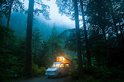 A Volkswagen Eurovan camper glows at night at the Mineral Park Campground in Mount Baker-Snoqualmie National Forest, Washington.