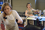 Windsor, Canada, 2014. Lauren Laplante, right, helps Lindsay Whalen with her letterpress run during a workshop at the Windsor Printmakers Forum. The workshop is part of the larger annual Mayworks Festival.