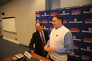 Ole Miss coach Houston Nutt, with Ole Miss sports information director Langston Rogers, talks about recruiting class on National Signing Day on Wednesday, February 3, 2010 in Oxford, Miss.