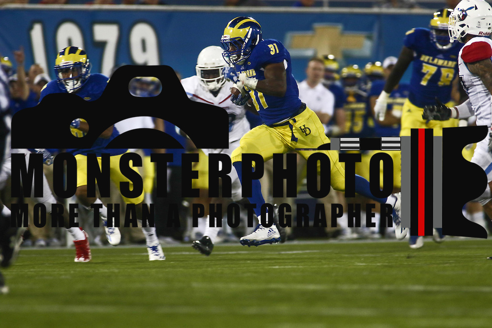 Delaware Running Back WES HILLS (31) rushes pass a  defender during a week one game between the Delaware Blue Hens and the Delaware State Hornets, Thursday, Sept. 01, 2016 at Tubby Raymond Field at Delaware Stadium in Newark, DE.