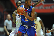 "SMU's Shawn Williams (2) vs. Ole Miss' Terrance Henry (1) at the C.M. ""Tad"" Smith Coliseum in Oxford, Miss. on Tuesday, January 3, 2012. Ole Miss won 50-48."