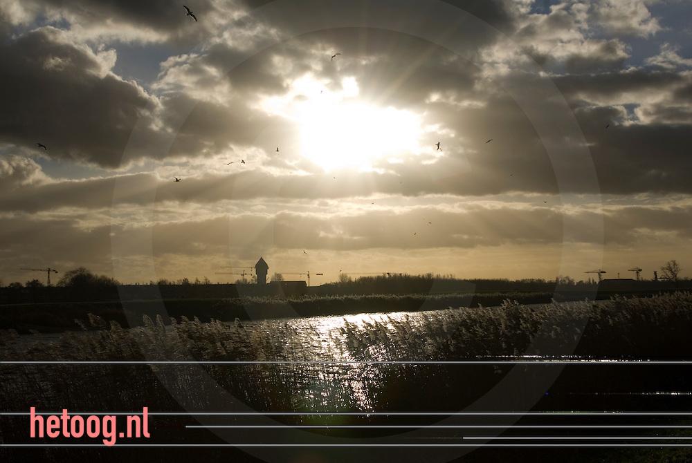 netherlands nederland ..zon breekt door de wolken een  polder van zuid-holland.
