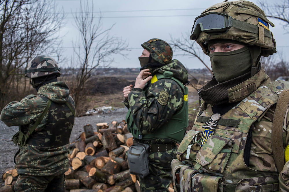 SARTANA, UKRAINE - FEBRUARY 5, 2015: Members of the St. Mary's Battalion, a pro-Ukraine militia, guard a checkpoint in Sartana, Ukraine. With more than 220 people having died in the past several weeks, a new diplomatic push is underway to bring an end to fighting between pro-Russia rebels and Ukrainian forces. CREDIT: Brendan Hoffman for The New York Times