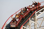Visitors ride the Cyclone roller coaster at the Astroland Amusement Park in New York, May 27, 2007. The Coney Island amusement closes for goods at the end of the 2007 season ahead of a major redevelopment that will raze much of the lovably seedy boardwalk area. REUTERS/Keith Bedford (UNITED STATES)