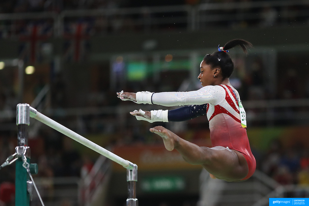 Gymnastics - Olympics: Day 4   Simone Biles of the United States performing her routine on the Horizontal bar during the Artistic Gymnastics Women's Team Final at the Rio Olympic Arena on August 9, 2016 in Rio de Janeiro, Brazil. (Photo by Tim Clayton/Corbis via Getty Images)
