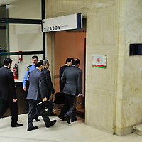 Iranian delegation arriving at the UN Palais des Nations, for the third, and eventually successful, round of the E3/EU+3 Iran talks in Geneva concerning Iran's nuclear program.  E3/EU +3 refers to UK, France and Germany plus U.S., Russia and China.