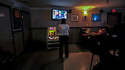 American Legion bartender, Lacey Russell, the wife of U.S. Army SPC Kaylan Russell, watches President Barack Obama during speech on ending combat operations in Iraq at her job Tuesday, August 31, 2010 in Hinesville, Ga. (AP Photo/Stephen Morton)