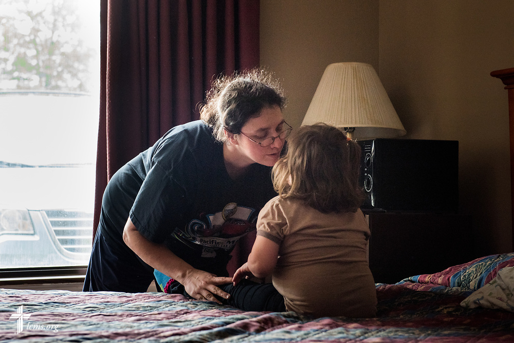 Amanda Prichard comforts her daughter Madalynn at a motel on Monday, May 1, 2017, in Eureka, Mo. Local LCMS congregations and LCMS Disaster Response are assisting the Lutheran family who have been displaced due to rising flood waters. LCMS Communications/Erik M. Lunsford
